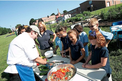Smart Partners' Bill Scepansky prepares pasta salad with students from Hamilton Elementary School in the School District of Lancaster. (Lancaster County magazine/Nick Gould)