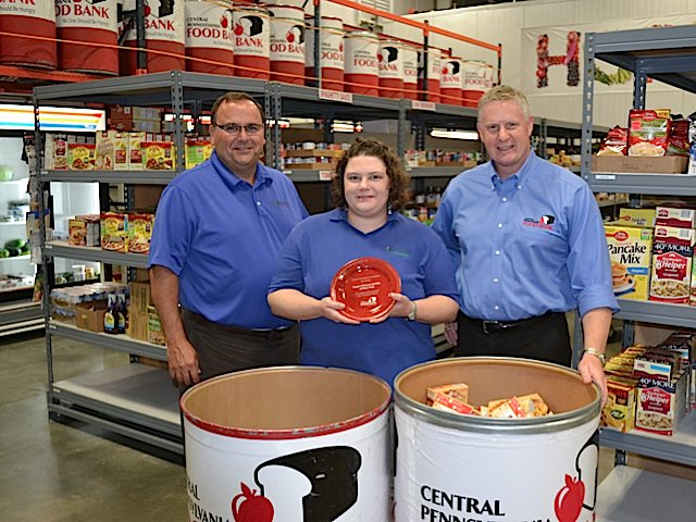 Greg Royer, CEO, Royer's Flowers & Gifts; Jackie Dahms, manager, Royer's West York store; Joe Arthur, executive director, Central Pennsylvania Food Bank. The West York store was recognized in 2013 for collecting the most pounds of food among Royer's 17 locations.